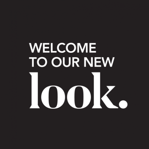 "Logo Concept - text ""Welcome to our new look."" on black"