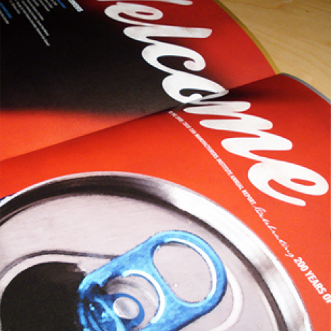 Annual report centerfold, showing red cans